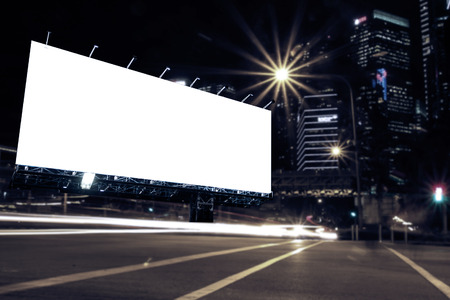 business exhibition: blank billboard at night time for advertisement city street night light , colored filter. Stock Photo