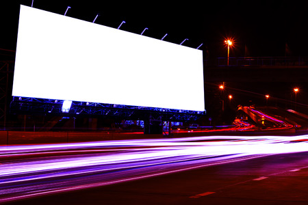 night market: blank billboard at night time for advertisement city street night light , colored filter. Stock Photo