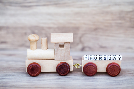 Miniature Figure Wood Train Toy Carry Block Thursday Text Over Wooden Background