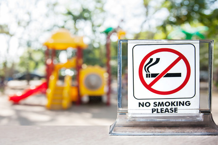 no smoking sign over blurred background,abstract background for no smoking concept.