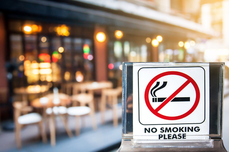 close up of no smoking sign over blurred background,abtract background for no smoking concept.