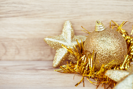 Christmas Decoration on wooden floor with Christmas glitter ball, Image for Christmas Holiday concept.