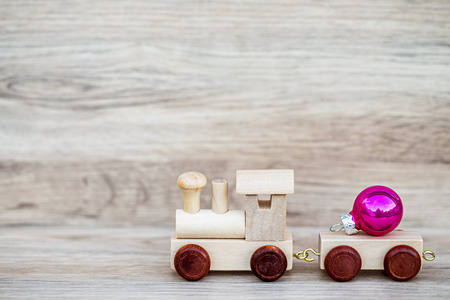 christmas toy: Miniature Figure Wood Train Toy Carry Text Over Wooden Background, Image For Christmas Concept.