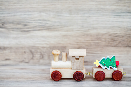 miniature: Miniature Figure Wood Train Toy Carry Text Over Wooden Background, Image For Christmas Concept.