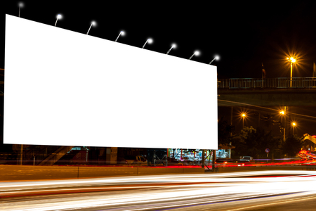 billboard blank for outdoor advertising poster at night time with street light line for advertisement street city night light concept. Imagens