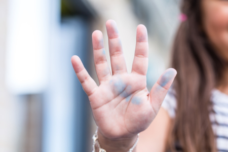 blurred of cute girl hand dirty with color painting.