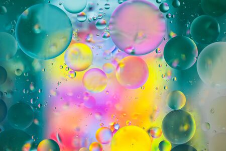 Colorful pastel artistic image of oil drop on water for modern and creation design background.