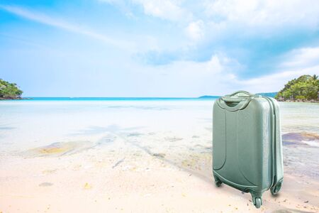 suitcase or luggage over tropical blue sea background, Image for business and travel on vacation concept