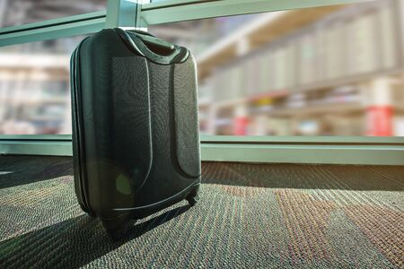 suitcase or luggage over airport  background , Image for business and travel on vacation concept.