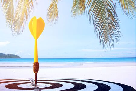 target dart with arrow over summer background ,image for target marketing holiday vacation concept .