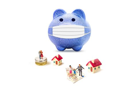 miniature family people with blue piggy bank isolate on white background.