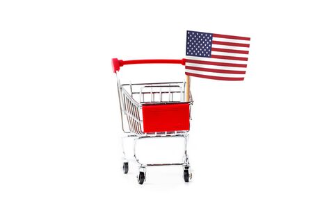 shopping cart and wooden calendar with United State flag isolated on white background, creative image for 4 July independent day celebrate concept. Reklamní fotografie