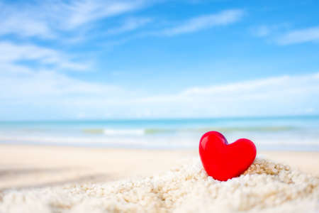 red Heart shape on white sand beach ,Image for love valentine day or summer vacation concept Archivio Fotografico