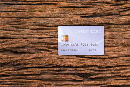 demo credit card on wooden background. 版權商用圖片
