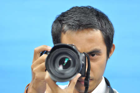 pastimes: Man to taking a picture
