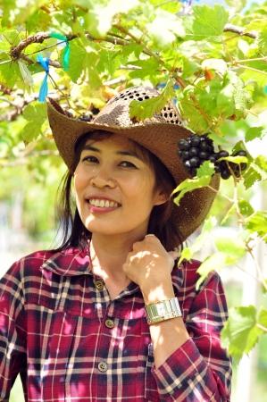 woman in grape farm photo