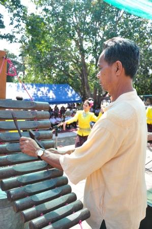 lang: Thai man is showing Xylophone called  Pong Lang  ,Kalasin , Thailand Editorial