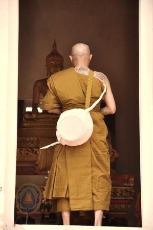 ordain: Khon Kaen,THAILAND  Dem 13 2012 : Newly ordained Buddhist monk pray with priest procession .Newly ordained Buddhist monks have a ritual in the temple procession in Khon Kaen Thailand