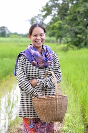 Lady thai farmer happy in farm Stock Photo