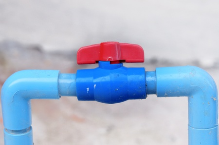 Water valve connects to PVC pipe. photo
