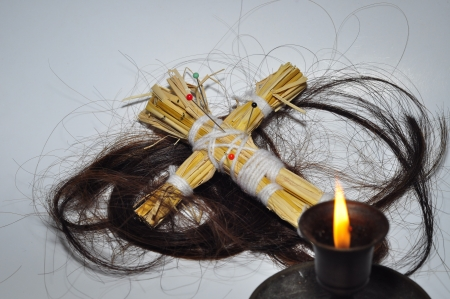 A Voodoo doll and long hair photo