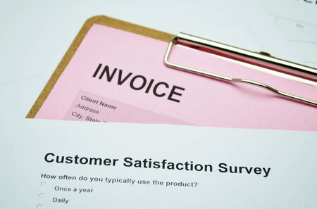 invoice: Business Document Invoice and Customer service surve Stock Photo