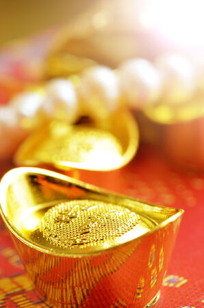 prosperous: Chinese new year and gold ingots Stock Photo