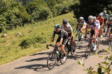 Group Tour de France 2012 riders climbing Col du Grand Colombier in France