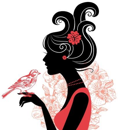 Silueta hermosa de la mujer con un pájaro