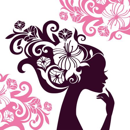 美しい女性のシルエットの花を持つ