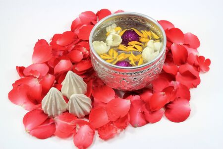 corolla: Water with jusmine and roses corolla in bowl and soft-prepared chalk for Songkran festival, Thailand