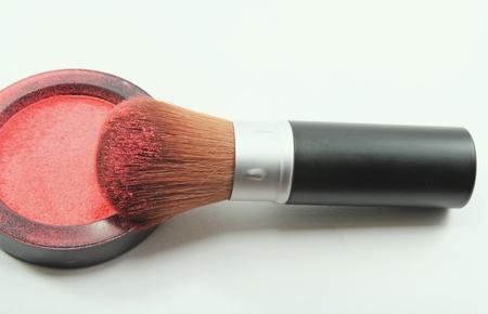 makeup brush and cosmetic powder close up, cosmetics