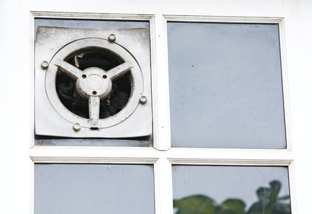 exhaust fan: Exhaust fan in the kitchen is embedded in the glass wall  Stock Photo