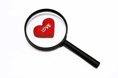 friend nobody: heart in magnifying glass on white background Stock Photo