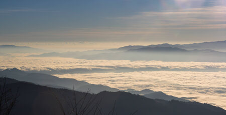 Layers of mountain and fog photo