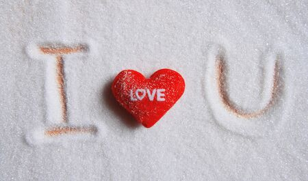 text i love you on sugar  background or Valentine photo