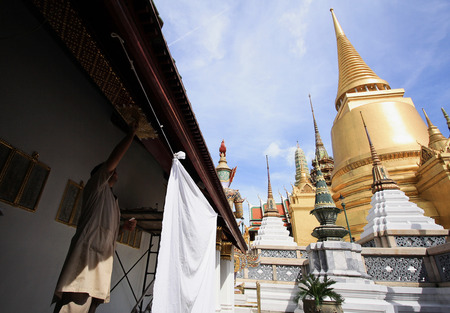 venerate: BANGKOK - THAILAND -  1 NOVEMBER 2014 : Skilled craftsman with Landscape and Pagodas in Wat Phra Kaew (the temple in grand palace) on Bangkok, Thailand