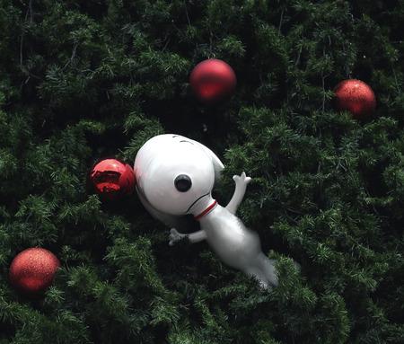 BANGKOK, THAILAND - DECEMBER 5, 2014 : Big Christmas tree and snoopy doll at Central Bangna shopping mall at night.