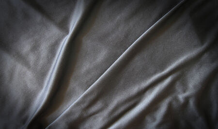 creased: Black creased material background or texture