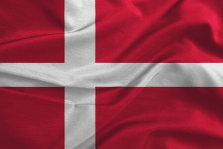Waving flag of Denmark. Flag has real fabric texture