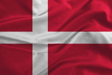 Waving flag of Denmark. Flag has real fabric texture