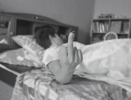obscene: Annoyed woman making obscene hand gesturestyle white black picture