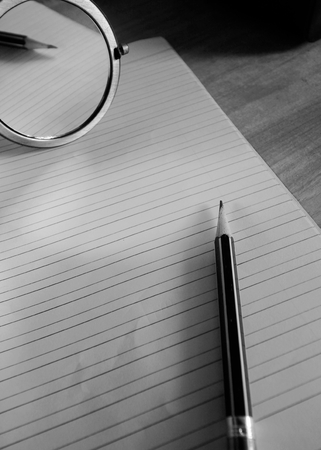 mirror image: pencil lying on a blank paper with a mirror image, Creative work, writing, drawing etc. blackandwhite mood Stock Photo