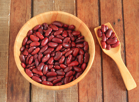 rajma: close up of a bowl of red beans and red beans on a wooden spoon