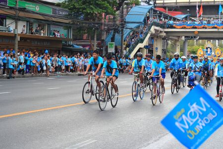 racer flag: BANGKOK, THAILAND - AUGUST 16, 2015: People cycling together in the event BIKE FOR MOM in Bangkok, Thailand.