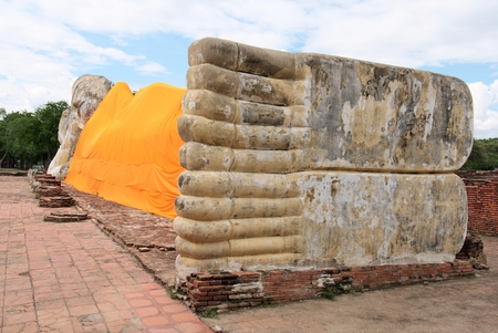 long toes: AYUTTHAYA-THAILAND : 9 August 2015 The largest reclining Buddha in the island city of Ayutthaya at Wat Lokaya Suttha, Buddha with a height of 8 meters long and 42 facing north. Pillow as lotus petals and long toes as well.
