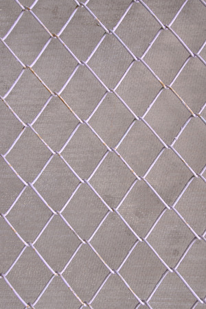 detain: Wire Mesh, iron wire fence wall gray background. Stock Photo