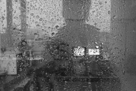 steamy: Water drop on glass style black and white, soft focus