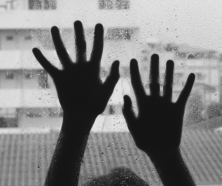 imprisoned: Horror woman behind the matte glass ,style  black and white, Blurry hand and body , soft focus