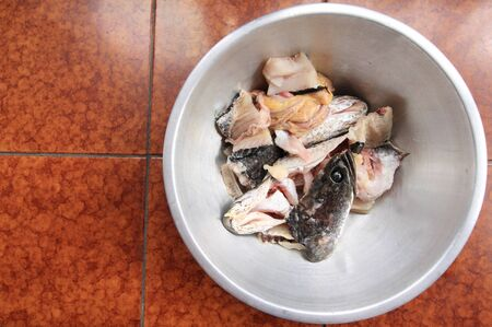 snakehead: fish meat and Giant snakehead fish in a bowl.